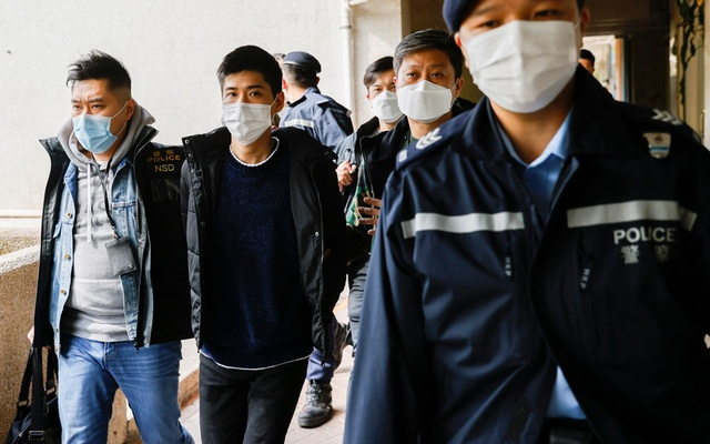 Pro-democracy activist Lester Shum is taken away by police officers as more than 50 Hong Kong activists are arrested under a security law in Hong Kong, China January 6, 2021. REUTERS