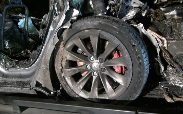 The remains of a Tesla vehicle are seen after it crashed in The Woodlands, Texas, April 17, 2021, in this still image from video obtained via social media.REUTERS