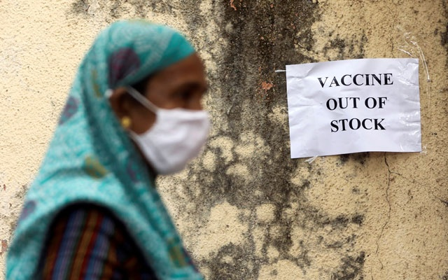 A notice about the shortage of coronavirus disease (COVID-19) vaccine supplies is seen at a vaccination centre, in Mumbai, India, April 8, 2021. REUTERS