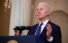 US President Joe Biden speaks in the Cross Hall at the White House in Washington, US, April 20, 2021. REUTERS