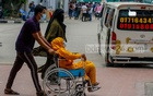 A woman suffering from COVID-19 is taken to the DNCC COVID-19 Dedicated Hospital in Mohakhali for treatment on April 22, 2021. Photo: Mahmud Zaman Ovi