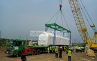 Workers move one of the first Dhaka Metrorail coaches from a barge to a trailer truck for transportation to Dhaka Mass Transit Company's depot at Diabari in Uttara on Thursday, Apr 22, 2021. Photo: Asif Mahmud Ove