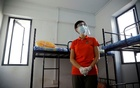 Singapore's Minister of Manpower Josephine Teo tours a dormitory room for migrant workers who have recovered from the coronavirus disease (COVID-19), amid the outbreak in Singapore May 15, 2020. REUTERS