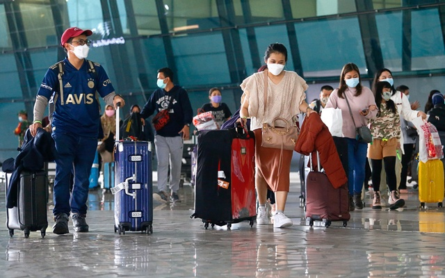 Visitors walk after they arrived at the Soekarno-Hatta Airport following Indonesia's government decision to ban foreign tourists from entry to prevent the spread of coronavirus disease (COVID-19), in Tangerang, on the outskirts of Jakarta, Indonesia, Jan 1, 2021. REUTERS