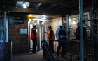 Authorities investigate the deaths of twin infants, a boy and a girl, who were found dead in an apartment in Woodside, Queens, on Thursday, April 22, 2021. The New York Times