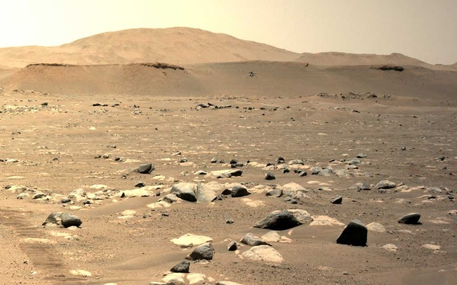 In a photo provided by NASA, NASA's Perseverance rover photographed the experimental helicopter known as Ingenuity during the vehicle's third flight on Mars on Sunday, April 25, 2021. The New York Times