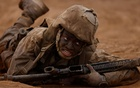A female recruit from US Marine Corps Recruit Depot San Diego participates in the gruelling crucible training as her platoon breaks a barrier becoming the first ever women Marines trained at Camp Pendleton, California, US, April 21, 2021. Reuters