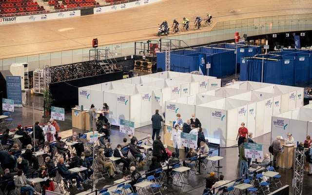 COVID-19 vaccines are administered at the Vélodrome de Saint-Quentin-en-Yvelines as the National cycling team trains, in Montigny-le-Bretonneux, France, April 9, 2021. The New York Times