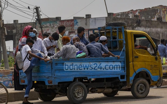 People taking a pick up truck ride to Savar or Manikganj from Amin Bazar Bridge amid a shutdown of public transport services due to the coronavirus outbreak on Wednesday, Apr 28, 2021. Photo: Mahmud Zaman Ovi
