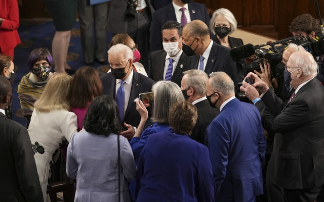 President Joe Biden greets lawmakers after delivering an address to a joint session of Congress at the Capitol in Washington, April 28, 2021. The New York Times