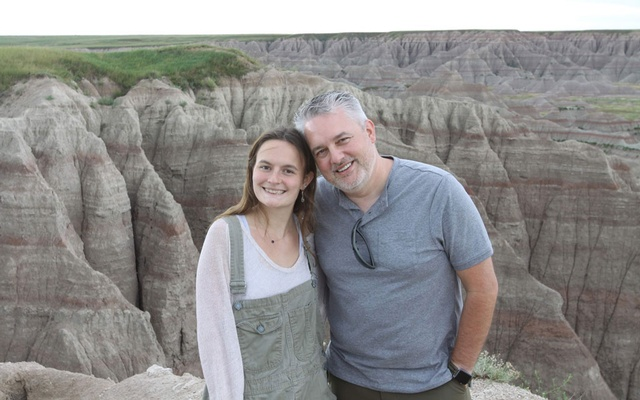 In an image provided by The Roth Family, Zoë Roth and her father, Dave, in Badlands National Park in 2019. After more than a decade of having her image endlessly repurposed as a vital part of meme canon, Zoë has sold the original copy of her meme as a nonfungible token, or NFT, for nearly half a million dollars. (The Roth Family via The New York Times)