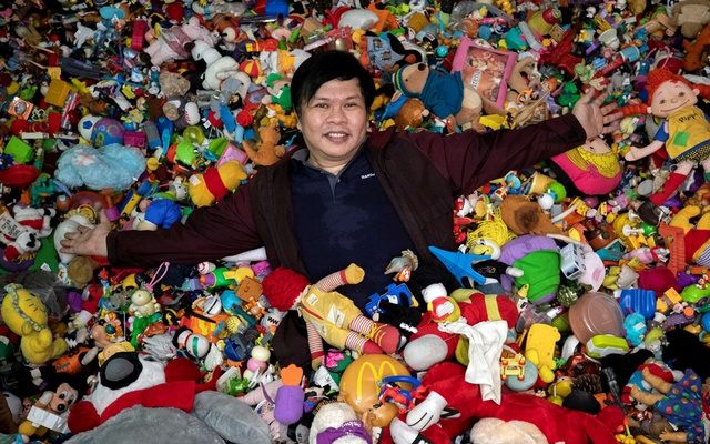 Percival Lugue, who has the Guinness world record for the largest fast-food toy collection, poses with his toy collection in his home in Apalit, Pampanga province, Philippines, April 20, 2021. REUTERS