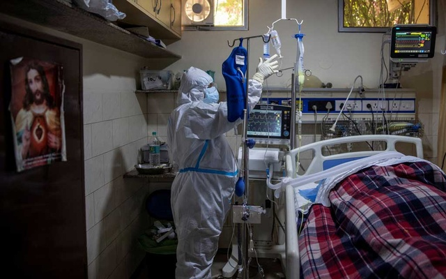 A medical worker tends to a patient suffering from the coronavirus disease (COVID-19), inside the ICU ward at Holy Family Hospital in New Delhi, India, April 29, 2021. REUTERS