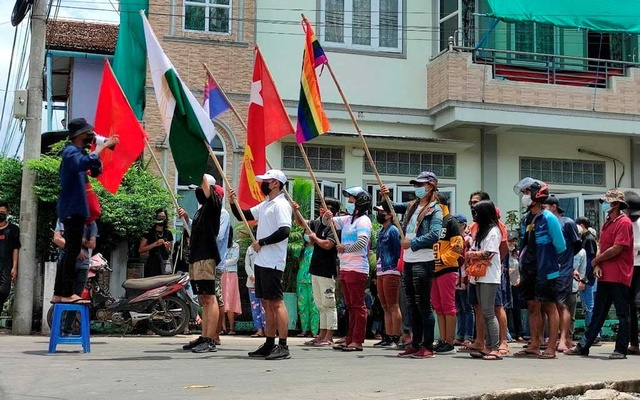 FILE PHOTO: Demonstrators carry flags during a protest against the military coup, in Dawei, Myanmar April 27, 2021. Courtesy of Dawei Watch/via REUTERS