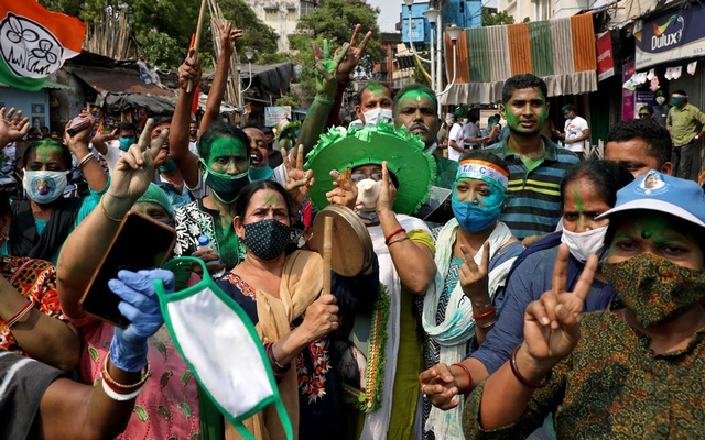Supporters of Chief Minister of West Bengal state and the Chief of Trinamool Congress (TMC) Mamata Banerjee celebrate after the initial poll results, amidst the spread of the coronavirus disease (COVID-19), in Kolkata, India, May 2, 2021. Reuters