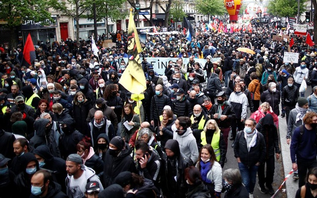 People attend the traditional May Day labour union march, amid the coronavirus disease (COVID-19) outbreak in Paris, France, May 1, 2021. REUTERS