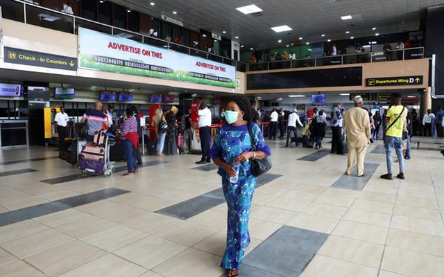 A woman wears a protective face mask due to the spread of the coronavirus disease (COVID-19), at the Murtala Mohammed International airport in Lagos, Nigeria March 19, 2020. Reuters