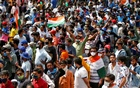 Fans react as they wait to enter the Narendra Modi Stadium before the start of the third test match between India and England in Ahmedabad, India, February 24, 2021.