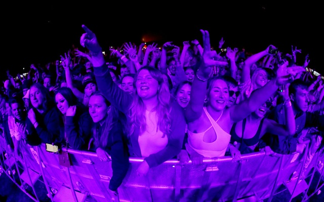 People attend a test music festival as part of a national research programme assessing the risk of COVID-19 transmission in Liverpool, Britain May 2, 2021. REUTERS