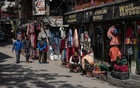 Shop owners wait for customers in Kathmandu on March 17, 2020. Nepal, desperate for tourist money, says it has taken steps to prevent a coronavirus outbreak, including social distancing at base camp and evacuation plans in case COVID-19 flares up. The New York Times