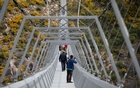 People walk on the world's longest pedestrian suspension bridge '516 Arouca', now open for local residents in Arouca, Portugal, April 29, 2021