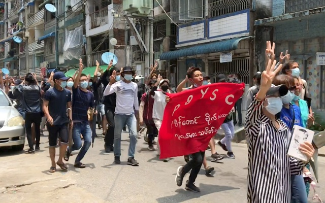 Demonstrators flash three-finger salute during a protest in Sanchaung, Yangon, Myanmar April 27, 2021 in this still image obtained from a social media video. Courtesy of NEWS AMBASSADOR/via REUTERS
