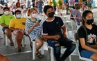 People from Klong Toey community line up for coronavirus disease (COVID-19) test, in Bangkok, Thailand, May 4, 2021. REUTERS