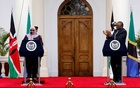 Tanzanian President Samia Suluhu Hassan and Kenya's President Uhuru Kenyatta attend a joint statement at State House, in Nairobi, Kenya, May 4, 2021. REUTERS