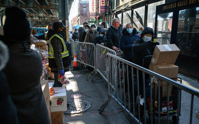 A line for food distribution in Brooklyn on Nov. 23, 2020, the Monday before Thanksgiving. Food banks have seen a sharp rise in demand this year. (Todd Heisler/The New York Times)