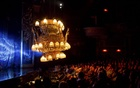 A chandelier is moved over the audience during the musical