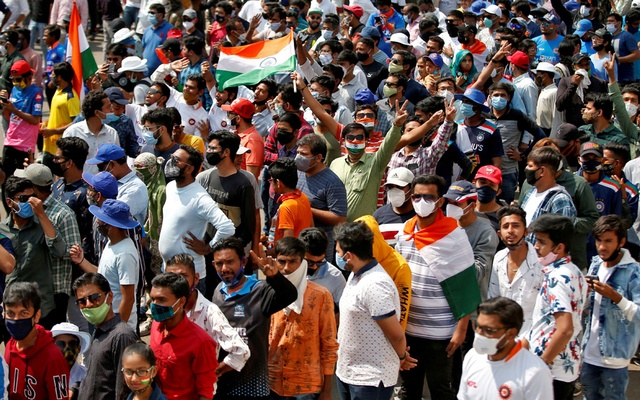 Fans react as they wait to enter the Narendra Modi Stadium before the start of the third Test match between India and England in Ahmedabad, India, February 24, 2021. REUTERS