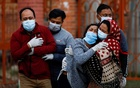 Family members mourn a coronavirus disease (COVID-19) victim as the country recorded the highest daily increase in death since the pandemic began, in Kathmandu, Nepal May 3, 2021. REUTERS