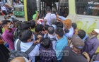 Passengers scramble to get on a bus in Dhaka's Farmgate on the first day of resumption of intra-city public transport services amid a coronavirus outbreak on Thursday, May 6, 2021.