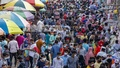People overcrowd the shops in Dhaka's New Market without maintaining physical distancing for shopping amid a second wave of deadly coronavirus infections on Friday, May 7, 2021 ahead of Eid-ul-Fitr.