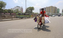 A man delivering goods by bicycle in Dhaka on Friday, May 7, 2021 as the e-commerce business enjoys a boost amid a coronavirus lockdown. Photo: Asif Mahmud Ove