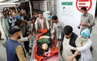 A woman being taken to a hospital following a bombing in Kabul on Saturday. Reuters