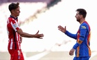 Barcelona's Lionel Messi shakes hands with Atletico Madrid's Marcos Llorente after the goalless draw at Nou Camp on Saturday. Reuters