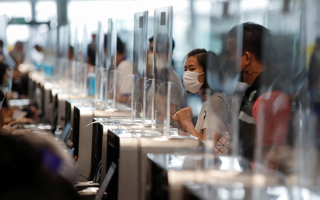 People line up to receive their vaccine against the coronavirus disease (COVID-19) at Suvarnabhumi airport in Bangkok, Thailand Apr 28, 2021. REUTERS