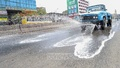 A Dhaka North City Corporation vehicle spraying water on the road in Dhaka's Gabtoli, May 8, 2021 as dry weather makes the streets dusty leading to a rise in air pollution. Photo: Asif Mahmud Ove