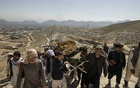 People perform a funeral ceremony for a girl killed in powerful explosions outside a high school in Afghanistan's capital of Kabul, May 9, 2021. The New York Times