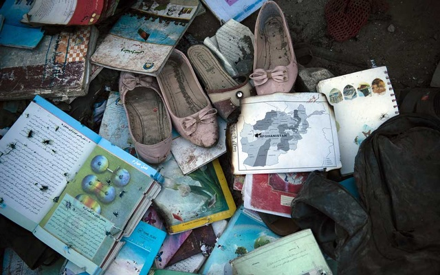 Items recovered outside Sayed Ul-Shuhada high school in Kabul, Afghanistan are laid out so families can identify and collect them after a bombing occurred that afternoon, on Saturday, May 8, 2021. The New York Times