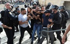 A Palestinian man is detained by undercover Israeli security force members amid Israeli-Palestinian tension as Israel marks Jerusalem Day, near Damascus Gate just outside Jerusalem's Old City May 10, 2021. Reuters
