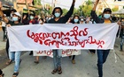 Students hold a banner and flash the three-finger salute as they take part in a protest against Myanmar's junta, in Mandalay, Myanmar May 10, 2021. REUTERS