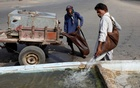 Mohammad Ramzan, a 60-year-old traditional goatskin water carrier also known as a mashki, fills a water trough for pigeons along a road on a hot and humid day during the fasting month of Ramadan, as the outbreak of the coronavirus disease (COVID-19) continues, in Karachi, Pakistan April 23, 2021. REUTERS