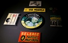 Memorabilia with the face of former South African President Nelson Mandela, are displayed at the Apartheid Museum, one of dozens of heritage attractions and art galleries around the country forced to close their doors due to the coronavirus disease (COVID-19) pandemic, in Johannesburg , South Africa, April 7, 2021. REUTERS
