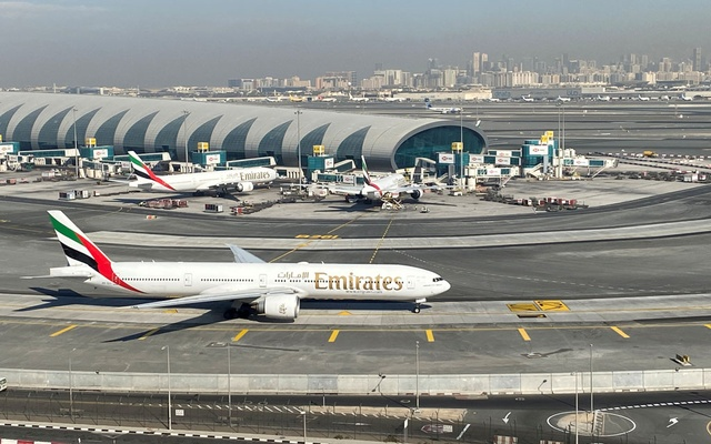 Emirates airliners are seen on the tarmac in a general view of Dubai International Airport in Dubai, United Arab Emirates Jan 13, 2021. REUTERS