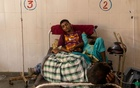 Patients receive treatment inside a COVID-19 ward of a government-run hospital, amidst the coronavirus disease (COVID-19) pandemic, in Bijnor district, Uttar Pradesh, India, May 11, 2021. REUTERS