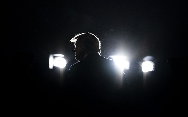 """FILE -- President Donald Trump, backlit by stage lights, at a campaign rally in Macon, Ga, Oct 16, 2020. """"With the ouster of Liz Cheney from her leadership position in the House of Representatives,"""" writes The New York Times opinion columnist Charles M Blow, """"the Republican Party has made absolutely clear that it is fully committed to Trump and the lie that he continues to propagate about the election: that he won and the election was stolen from him."""" (Doug Mills/The New York Times)"""
