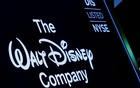 A screen shows the logo and a ticker symbol for The Walt Disney Company on the floor of the New York Stock Exchange (NYSE) in New York, US, December 14, 2017. REUTERS