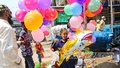 A child buys multi-coloured balloons after Eid prayers at the Baitul Mukarram National Mosque in Dhaka on Friday, May 14, 2021. Photo: Asif Mahmud Ove